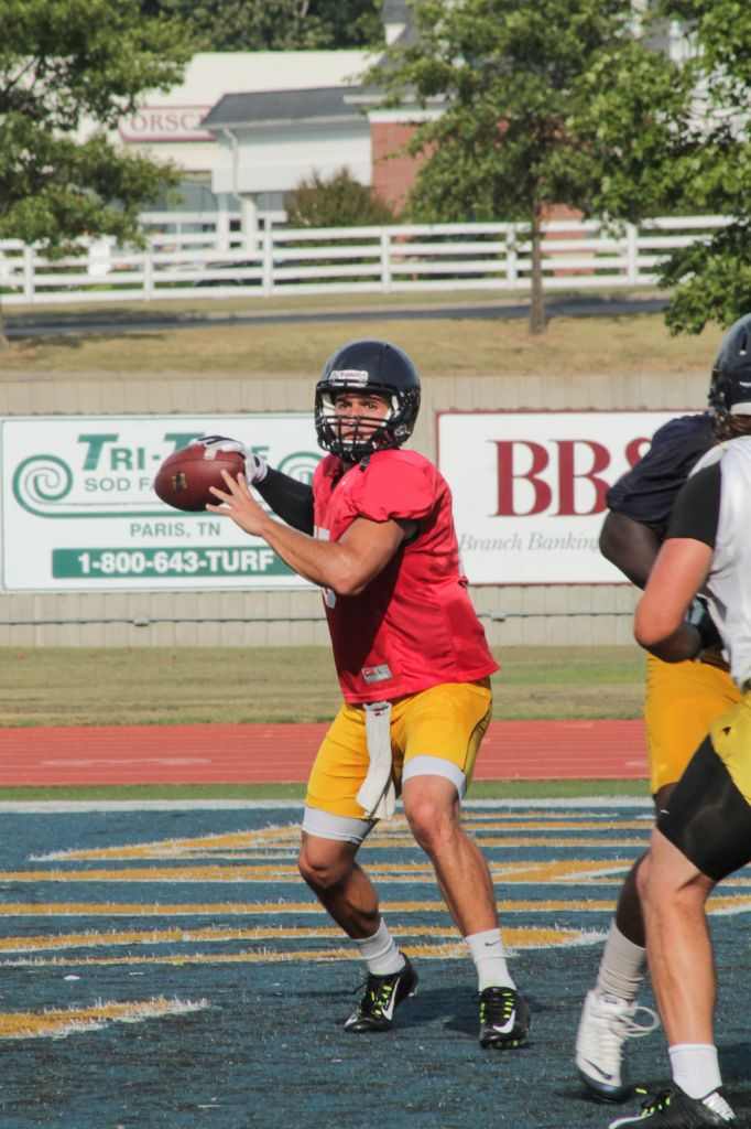 Jenny Rohl/The News Senior quarterback C.J. Bennett prepares to pass during practice at Roy Stewart Stadium Wednesday.