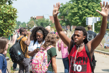 Photos by Kory Savage/The News Students joined outside of Waterfield Library Thursday to protest the shooting of Michael Brown in Ferguson, Mo.