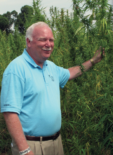 Bruce Schreiner/AP Photo In this Aug. 1, 2014 photo, Tony L. Brannon, Murray State University's agriculture dean, stands for a photo near a hemp crop at the school's research farm in Murray, Ky. Researchers and farmers are producing the state's first legal hemp crop in generations. Hemp has turned into a political cause in the Bluegrass state.