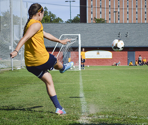 Hannah Fowl/The News GOAL ORIENTED: Junior forward Julie Mooney practices corner kicks at Cutchin Field. Mooney scored four goals in two games against Indiana University-Purdue University Indianapolis and Northern Kentucky and was voted OVC Player of the week by the league's sports information directors.