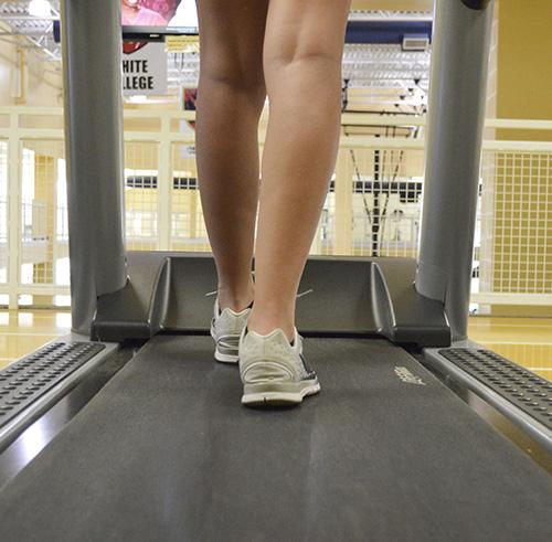 Hannah Fowl/The News A student walks on the treadmill at the Wellness Center.