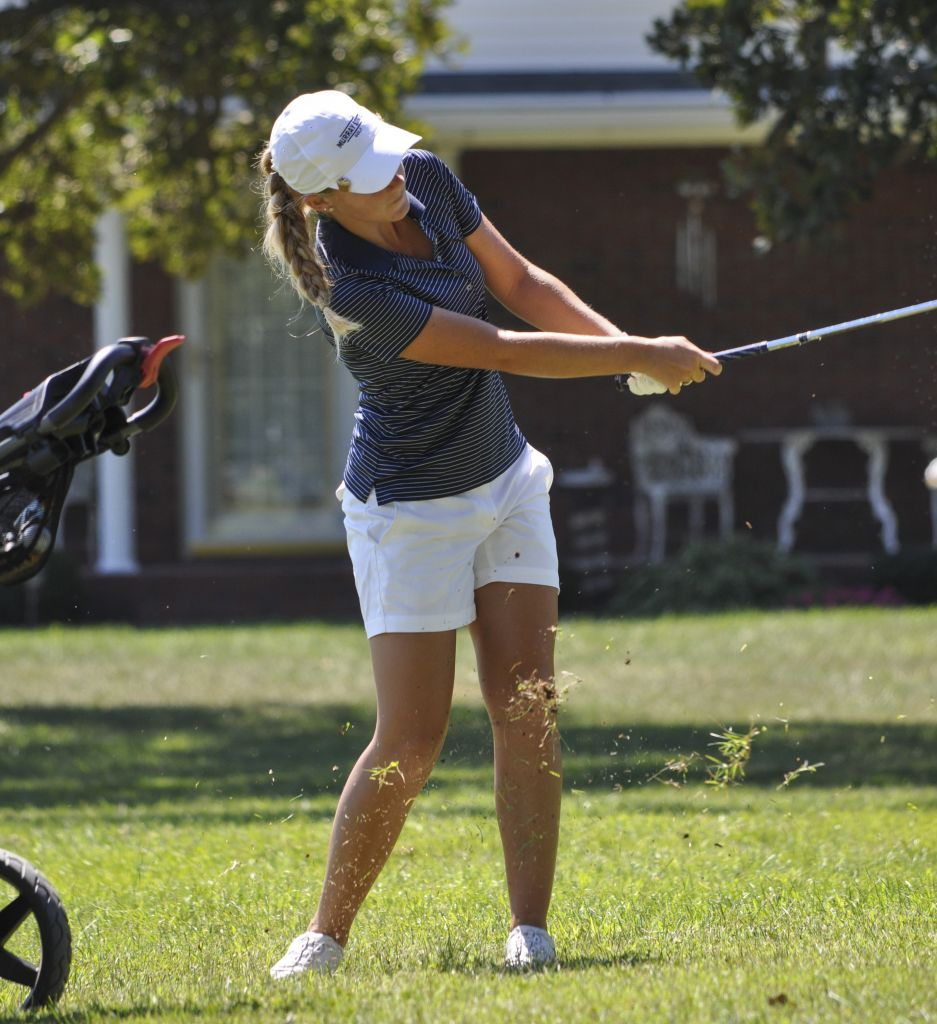 Kylie Townsend/The News Sophomore Sydney Trimble finishes a swing Monday at Drake Creek Golf Course in Ledbetter, Ky.