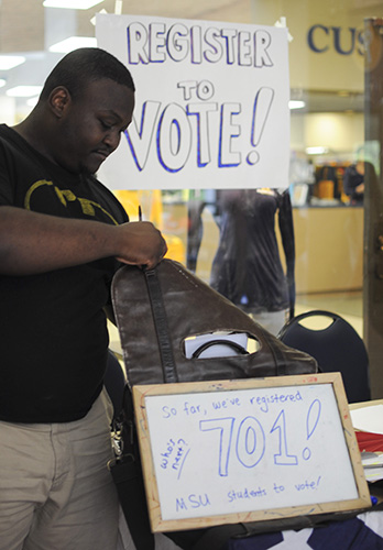 Lori Allen/The News A student stands at a voter registration booth inside the Curris Center.