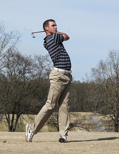 Jenny Rohl/The News Junior Brock Simmons follows through a swing at Frances E. Miller Memorial Golf Course last season.