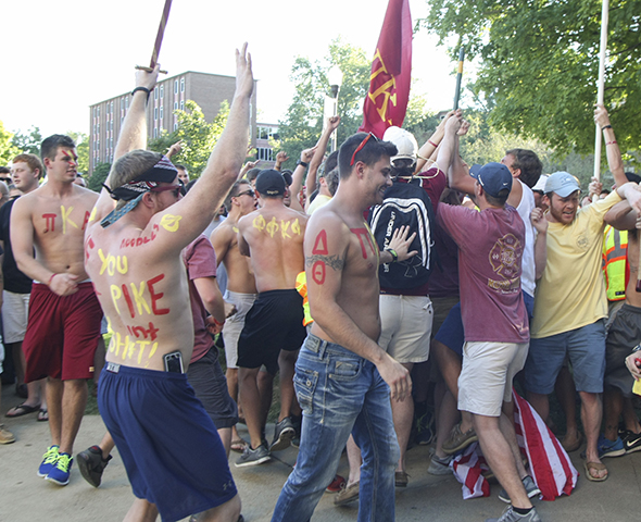 Haley Hays/The News Members of Pi Kappa Alpha welcome the men who accepted their bids Monday at Lovett Auditorium.