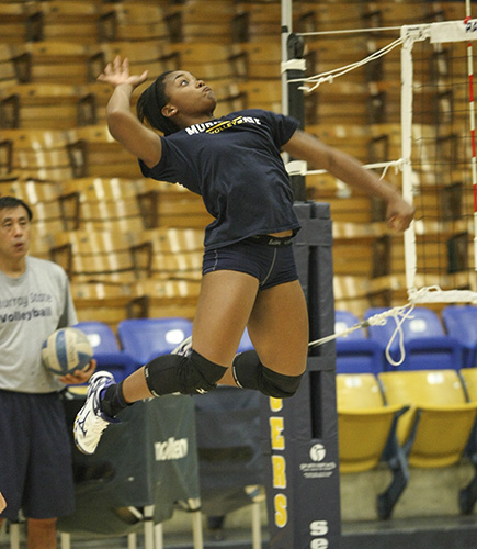 Haley Hays/The News Sophomore outside hitter Kamille Jones practices at Racer Arena last week.