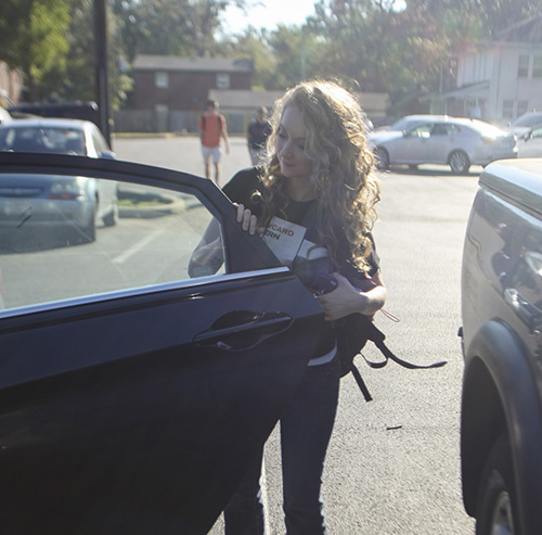 Haley Hays/The News Abby McWherter, senior from Benton, Ky., gets into her car in a red zone commuter lot.