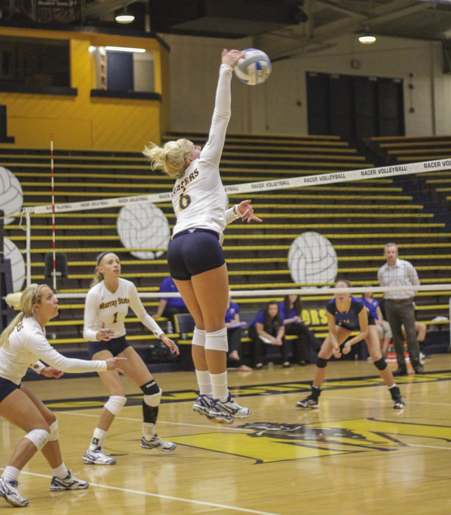 Lori Allen/The News Senior Taylor Olden spikes the ball in a home game last season. Olden will continue her Racer career this year.