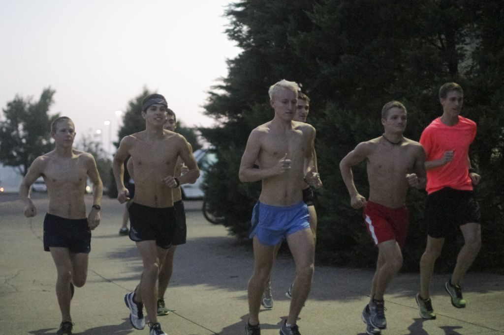 Jenny RohlThe News The men's cross country team takes a run early Thursday morning.