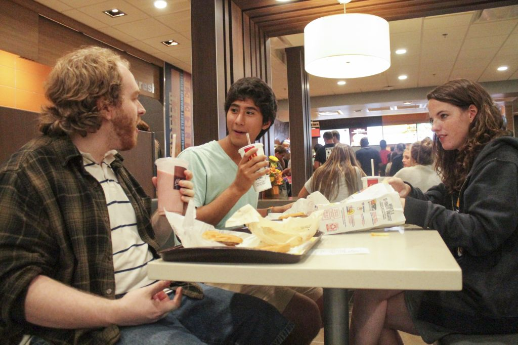Jenny Rohl/The News Students find a table in the busy restaurant and sit down to enjoy the McDonald's food they have been without all summer.