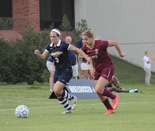 Jenny Rohl/The News Senior forward Julie Mooney dribbles past an IUPUI defender Sept. 19 at Cutchin Field.