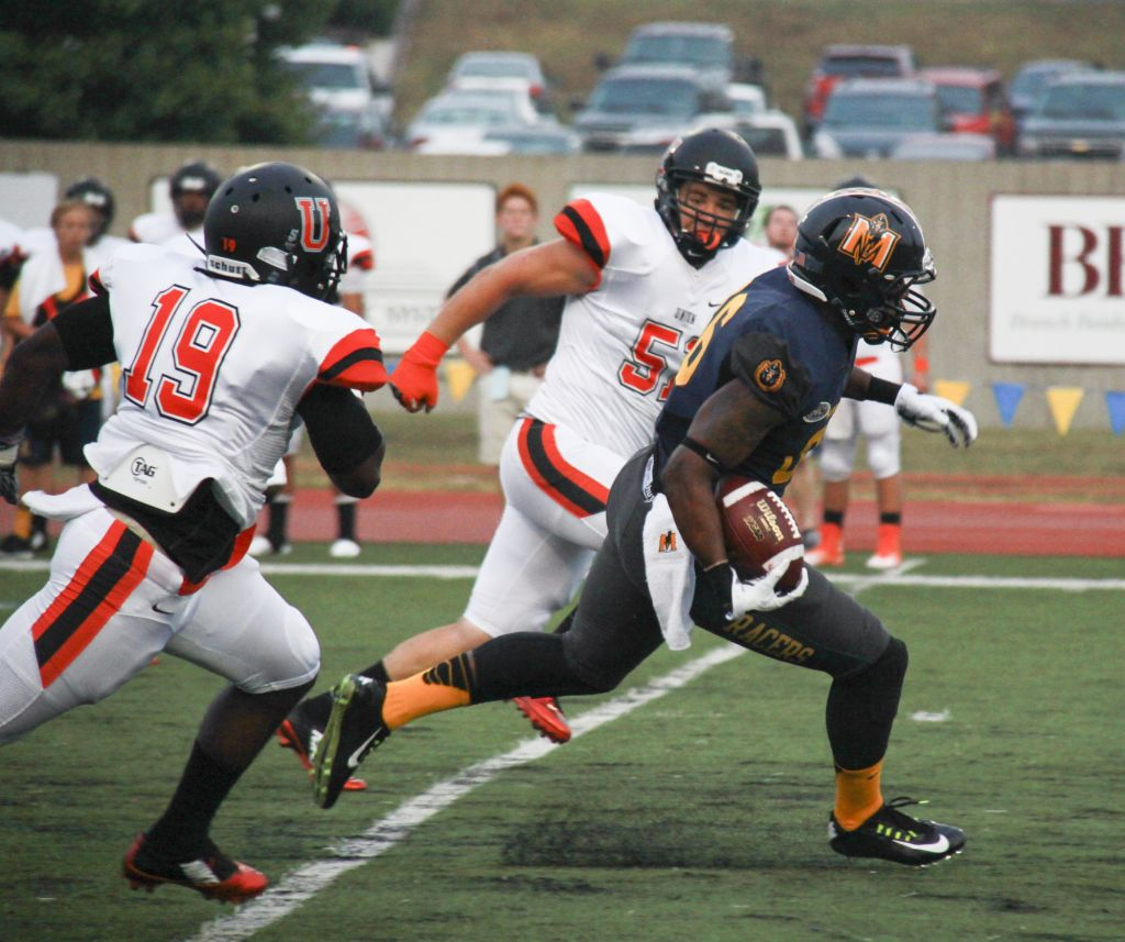 Fumi Nakamura/The News Sophomore Marcus Holliday carries the ball in the season opener against Union College, where Murray State won 73-26.