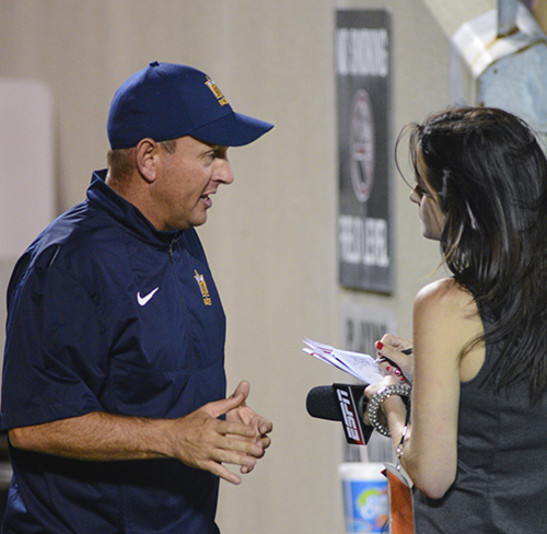 Kory Savage/The News Head Coach Chris Hatcher talks to a reporter at the University of Louisville game Sept. 6.