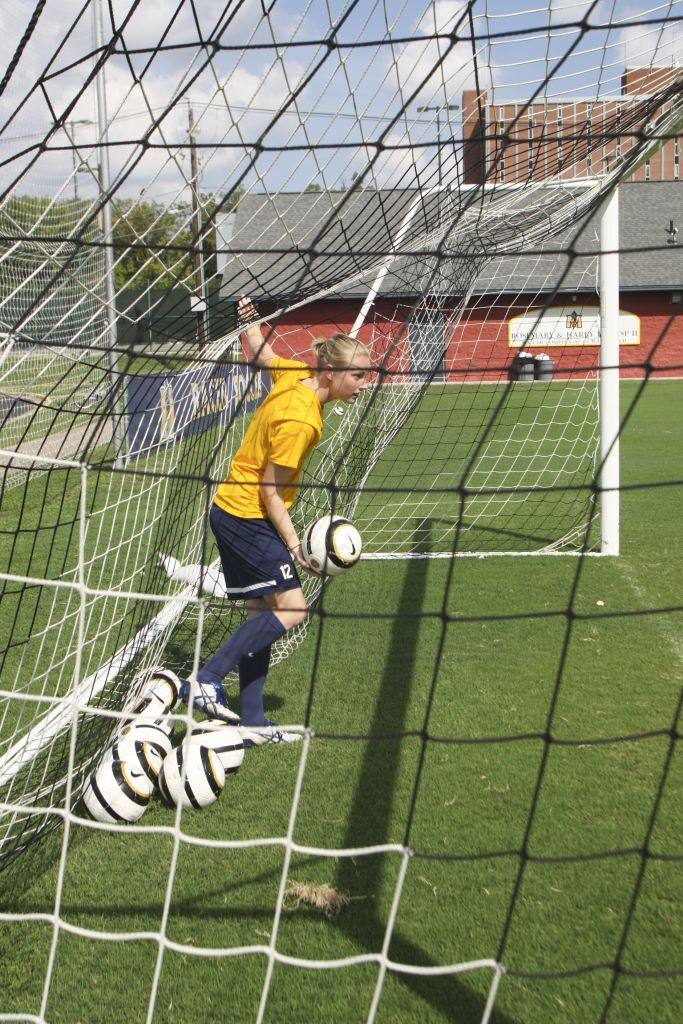 Haley Hays/The News Freshman Harriet Withers stands in the goal at practice Thursday morning.
