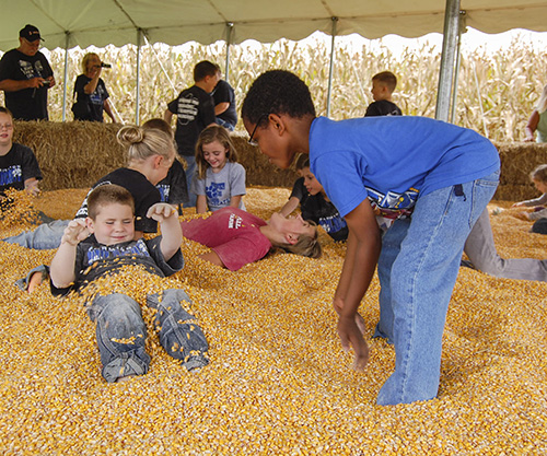 File Photo Children enjoy the corn pit at the annual Fall on the Farm event last year at Stanley Pullen Farm. The event is operated by Murray State students.