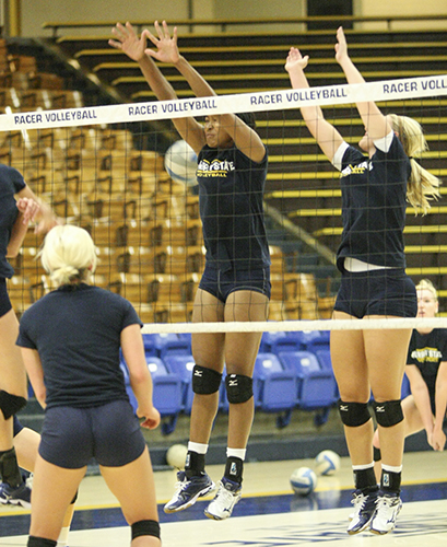 File Photo Middle blockers practice at Racer Arena before starting OVC play.