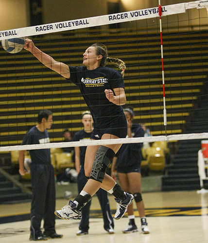 Haley Hays/The News Junior outside hitter Audrey Lewis punches a ball during practice Tuesday at Racer Arena.