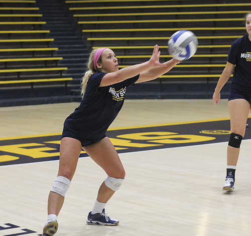 Jenny Rohl/The News Sophomore libero Ellie Lorenz sets a ball at practice Tuesday at Racer Arena.