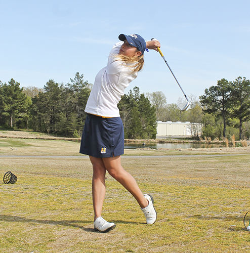 Jenny Rohl/The News Senior Gina Nuzzo follows a swing during practice last semester at Frances E. Miller Memorial Golf Course.