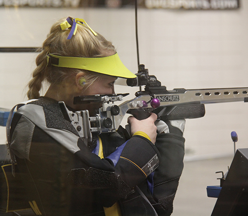 File Photo Junior Kaitlyn Wilson aims during a meet at Pat Spurgin Rifle Range in January 2014.