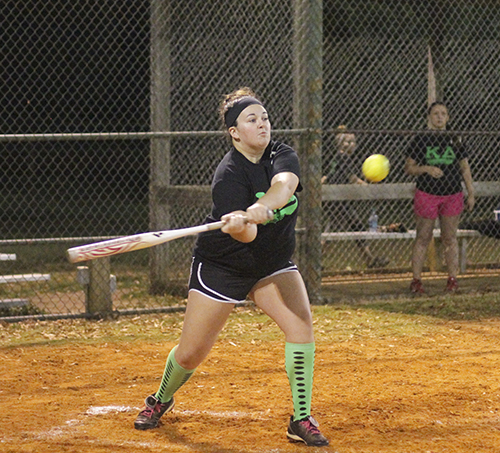 Jenny Rohl/The News Cierra Massengale, sophomore from Benton, Ky., bats for Kappa Delta Tuesday night against Regents Residential College.