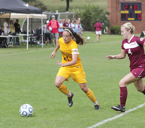 Jenny Rohl/The News Junior defender Taylor Stevens dribbles past an Eastern Kentucky player Sunday at Cutchin Field.