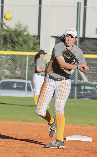 Jenny Rohl/The News Infielder, senior Alexa Becker from Goreville, Ill., throwing a pitch at  the intra-squad scrimmage Oct 17.