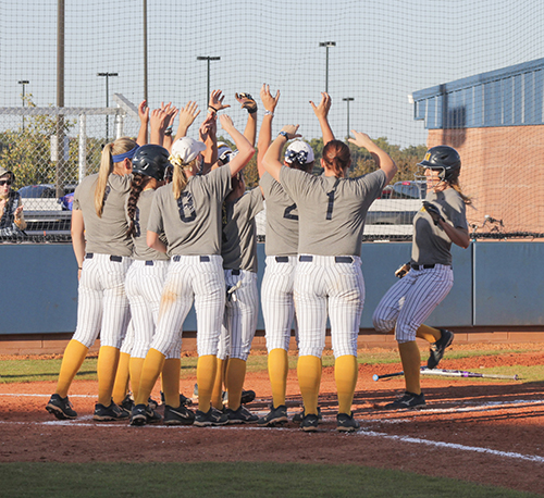 Jenny Rohl/The News The Racers celebrate the end of their 5-1 season at the Racer Field.