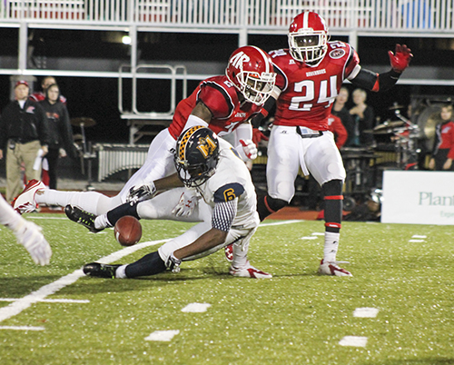 Jenny Rohl/The News Sophomore runningback Marcus Holliday drops a ball as Austin Peay State players pressure him at Governors Stadium Saturday.