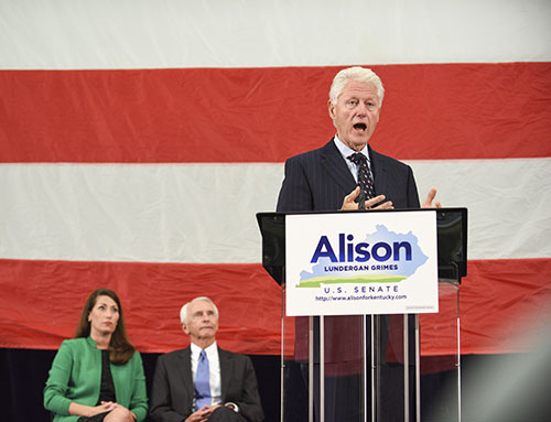 Kory Savage/The News Formerpresident Bill Clinton speaks to a crowd in western Kentucky as congressional candidate Alison Lundergan Grimes and Gov. Steve Beshear watch from behind.