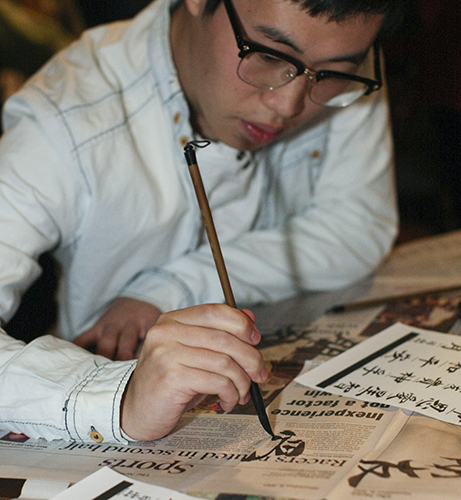 Haley Hays/The News Chinese international student, Xiankun Xu, showcases his calligraphy at a workshop Monday.