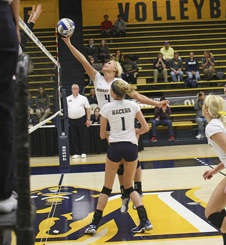 Haley Hays/The News Junior setter Sam Bedard pushes the ball over the net during their opening Championship game Thursday night.