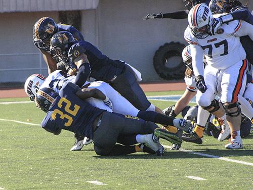 Kalli Bubb /The News Sophomore linebacker Jonathan Jackson tackles a UT Martin Skyhawks player.