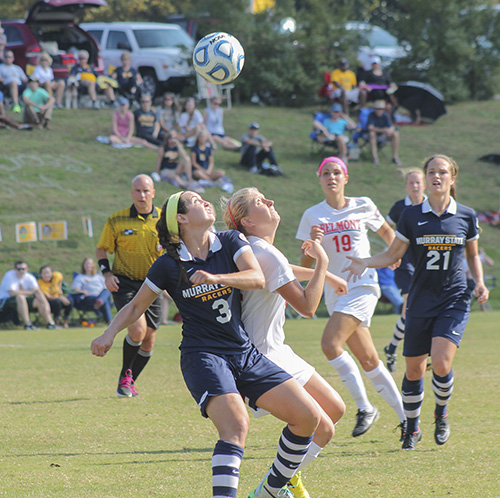 Jenny Rohl/The News Senior Julie Mooney battles a Belmont Bruin for a header during the Oct. 26 game at Cutchin Field.