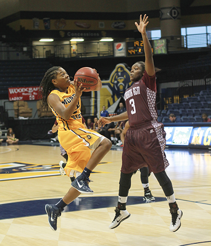 Jenny Rohl/The News Freshman point guard, Olivia Cunningham shooting against an Alabama A&M Bulldog point guard.