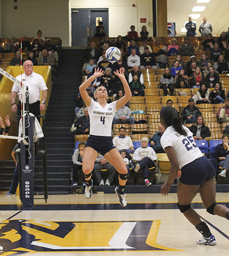 Jenny Rohl/The News Junior Sam Bedard sets up freshman Olivia Chatman against Austin Peay State Tuesday at Racer Arena.