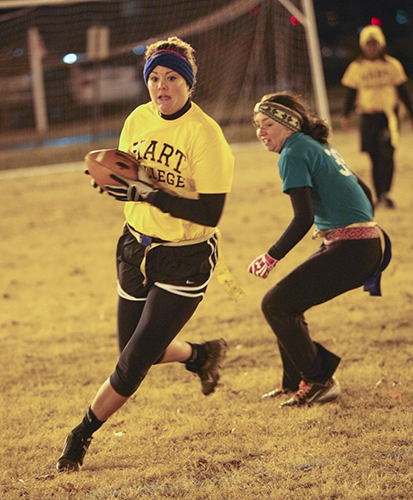 Haley Hays/The News Hart Ravens' player Amber Timmerman runs the ball against Springer-Franklin A Tuesday night.
