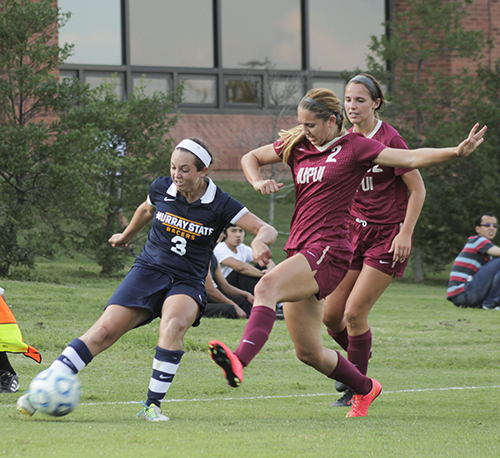 Jenny Rohl/The News Senior forward Julie Mooney keeps the ball away from two IUPUI players Sept. 19 at Cutchin Field.