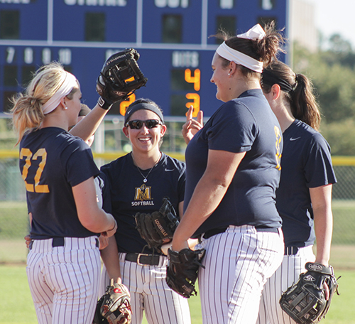 Jenny Rohl/The News The infielders gather to talk during an intrasquad scrimmage earlier this season at Racer Field.