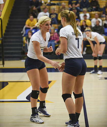 Photo by Kory Savage/The News Junior setter Sam Bedard strategizes with sophomore outside hitter Scottie Ingram at the final game against Belmont Nov. 20 in Racer Arena.