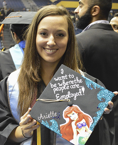 Hannah Fowl/The News Arielle Lyford, graduate from Elizabethtown, Ky., holds her decorated Ariel cap from December's graduation.