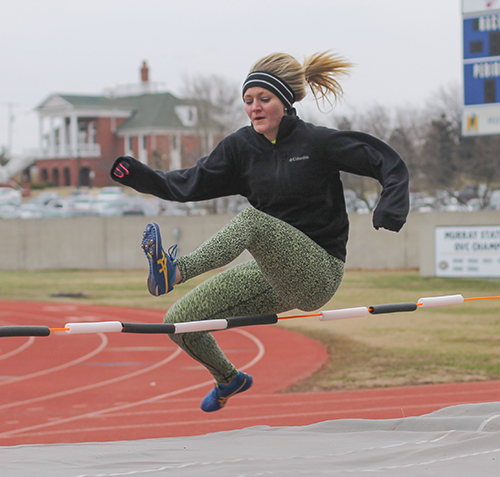 Jenny Rohl/The News Lauren Miller, junior from Benton, Ky., high jumps for the first time at track and field practice.