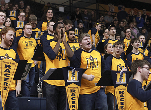 Jenny Rohl/The News The Racer Pep Band cheers on the Racers Saturday night at the CFSB Center during their 91-72 victory over Tennessee State. Regular basketball game attendance is expected of its members, according to RacerBand.com.