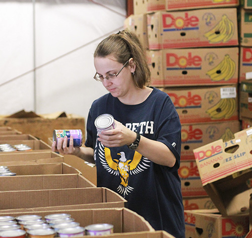 Jenny Rohl/The News Christina Morgan, graduate student from Murray, volunteers at Need Line during the Martin Luther King Jr. Service Day.
