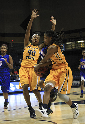 Kalli Bubb/The News Above: Freshman guard Olivia Cunningham and senior forward Chanyere Hosey defend against Tennessee State players.