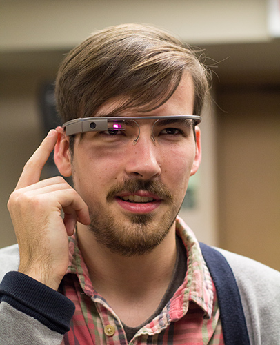 Fumi Nakamura/The News Ben Manhanke, Chief Videographer for The News, uses Waterfield Library's Google Glass.