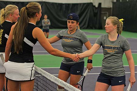 Photo courtesy of Racer Athletics  Doubles players, senior Andrea Eskauriatza and junior Erin Patton, shake the hands of the Lipscomb University Bisons after their match.