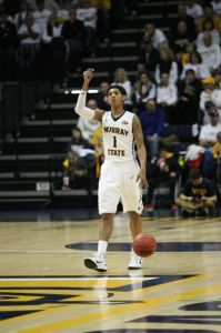 Haley Hays/The News Sophomore point guard Cameron Payne leads the Racer offense as he takes the ball downcourt.