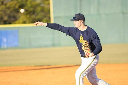 Haley Hays/The News The baseball team practices for their season opener that ended in loss against the Golden Eagles.