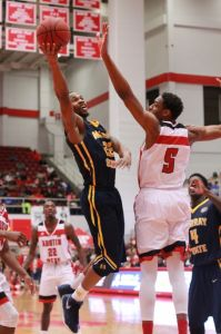 Jenny Rohl/The News Senior guard T.J. Sapp goes in for a layup as Austin Peay State's Chris Horton attempts to block.